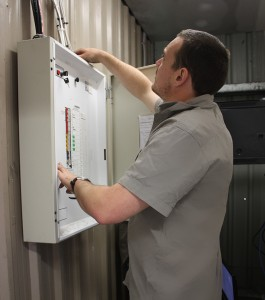 MFE electrician checking exit and emergency lights